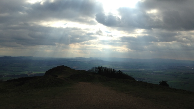 Many miles from home at the top of the Wrekin, Shropshire looking towards Wales.                                                                                    It was a pretty tough climb for an old  Southerner - climbing 240m in 2km off-road.